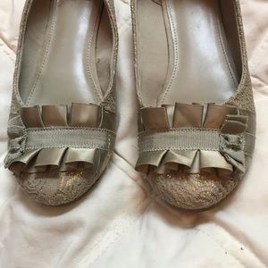 Fergalicious gold lace flats with bow detail